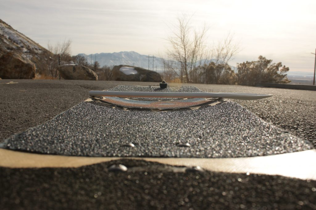 Photo of the mid-concave on an Ivey Longboards Convergence deck
