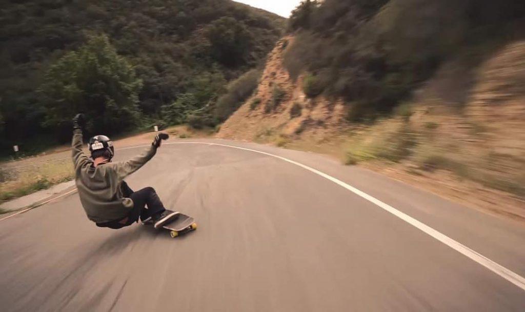 Photo of Brett Ciabattini sliding into a left corner
